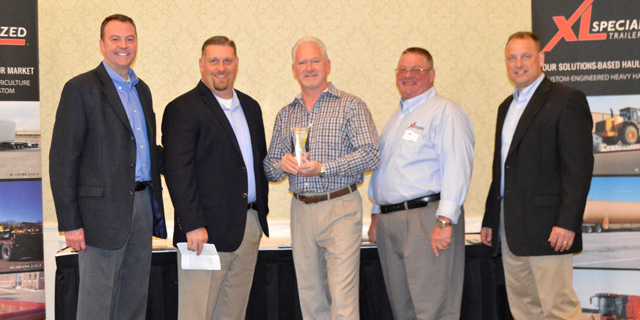 Pictured from left to right: Bull Moose Heavy Haul's Matt Harper, XL's Rodney Crim, Pinnacle's Chuck Guinn, XL's Dennis Wall, XL's Jeff Ingels, as XL presents Pinnacle with its Dealer of the Year award for 2016